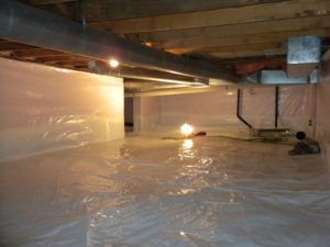 A home crawl space that has been encapsulated with a plastic barrier to prevent mold.