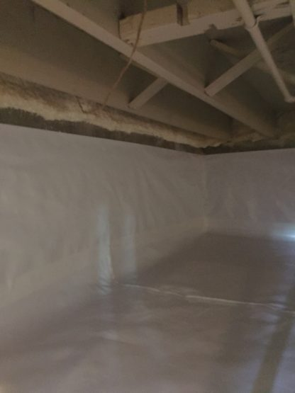 Whitecap premium crawlspace liner installed to the floor and walls the crawl space in a Brookfield, IL home.