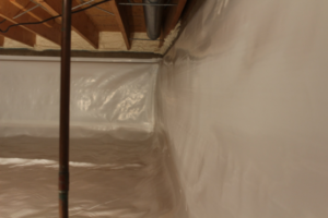 A basement crawl space with an encapsulation system.
